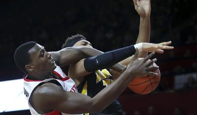 Rutgers center Shaquile Doorson, left, of Netherlands, makes a steal from Iowa forward Cordell Pemsl during the first half of an NCAA college basketball game Tuesday, Jan. 31, 2017, in Piscataway, N.J. (AP Photo/Mel Evans)