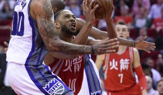 Houston Rockets guard Eric Gordon (10) drives for a shot against Sacramento Kings center Willie Cauley-Stein (00) during the first half of an NBA basketball game Tuesday, Jan. 31, 2017, in Houston. (AP Photo/George Bridges)