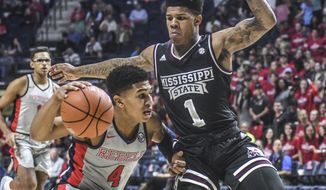 Mississippi guard Breein Tyree (4) is defended by Mississippi State Bulldogs guard Lamar Peters (1) during an NCAA college basketball game in Oxford, Miss., Tuesday, Jan. 31, 2017. (Bruce Newman/Oxford Eagle via AP)