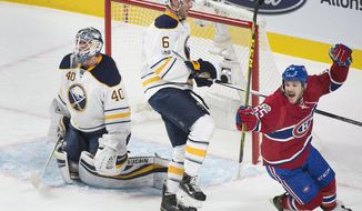 Montreal Canadiens' Andrew Shaw (65) celebrates a goal by teammate David Desharnais as Buffalo Sabres goaltender Robin Lehner and Cody Franson react during second period NHL hockey action in Montreal, Tuesday, Jan. 31, 2017. (Graham Hughes/The Canadian Press via AP)