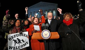 A protest rally on the steps of the Supreme Court by the Democratic leadership turned into a bit of an embarrassment Monday evening when House Minority Leader Nancy Pelosi (center) couldn't get her mic to work, leading to an impromptu hymn singing. (Associated Press)