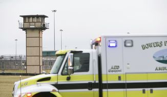 More ambulances arrive on scene as all Delaware prisons went on lockdown Wednesday, Feb. 1, 2017,  due to a hostage situation unfolding at the James T. Vaughn Correctional Center in Smyrna. Geoffrey Klopp, president of the Correctional Officers Association of Delaware, said he had been told by the Department of Correction commissioner that prison guards had been taken hostage.  (Suchat Pederson/The Wilmington News-Journal via AP)