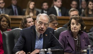 Senate Judiciary Committee Chairman Sen. Chuck Grassley, R-Iowa, joined by the committee's ranking member, Sen. Dianne Feinstein, D-Calif., starts the roll call on Capitol Hill in Washington, Wednesday, Feb. 1, 2017, as the panel voted to approve the nomination of Attorney General-designate Sen. Jeff Sessions, R-Ala., following angry exchanges between Republicans and Democrats, on Capitol Hill in Washington, Wednesday, Feb. 1, 2017. (AP Photo/J. Scott Applewhite) ** FILE **
