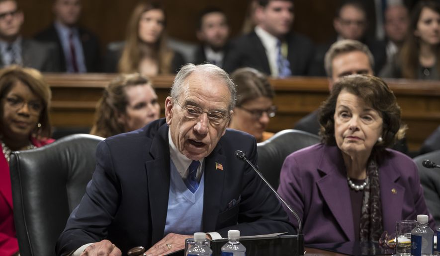 Senate Judiciary Committee Chairman Sen. Chuck Grassley, R-Iowa, joined by the committee's ranking member, Sen. Dianne Feinstein, D-Calif., starts the roll call on Capitol Hill in Washington, Wednesday, Feb. 1, 2017,  as the panel voted to approve the nomination of Attorney General-designate Sen. Jeff Sessions, R-Ala., following angry exchanges between Republicans and Democrats, on Capitol Hill in Washington, Wednesday, Feb. 1, 2017. (AP Photo/J. Scott Applewhite)