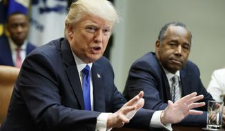 Housing and Urban Development Secretary-designate Ben Carson listens at right as President Donald Trump speaks during a meeting on African American History Month in the Roosevelt Room of the White House in Washington, Wednesday, Feb. 1, 2017. (AP Photo/Evan Vucci)