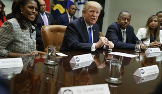 President Donald Trump speaks during a meeting on African American History Month in the Roosevelt Room of the White House in Washington, Wednesday, Feb. 1, 2017. From left are, Omarosa Manigault, Trump, Housing and Urban Development Secretary-designate Ben Carson, and Lynne Patton. (AP Photo/Evan Vucci)