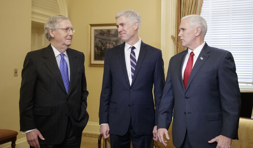 Supreme Court Justice nominee, Neil Gorsuch, center, is joined by Vice President Mike Pence, right, as they meet with Senate Majority Leader Mitch McConnell of Ky. on Capitol Hill in Washington, Wednesday, Feb. 1, 2017. Last year, Senate Republicans, led by McConnell, blocked a confirmation hearing for Judge Merrick Garland, President Barack Obama's pick for the vacancy left by the death of Justice Antonin Scalia who died in February 2016. (AP Photo/J. Scott Applewhite)