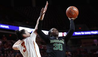 Baylor guard Alexis Jones (30) drives to the basket past Iowa State guard Emily Durr during the first half of an NCAA college basketball game, Wednesday, Feb. 1, 2017, in Ames, Iowa. (AP Photo/Charlie Neibergall)