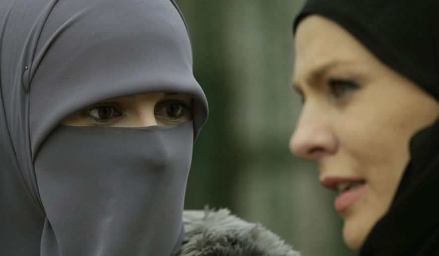 Bosnian Muslim women talk during events to observe World Hijab Day, celebrating the veil traditionally worn by Muslim women, in Sarajevo, Bosnia, on Wednesday, Feb. 1, 2017.  World Hijab Day was initiated in New York in 2013 and has since attracted interest around the world. (AP Photo/Amel Emric)