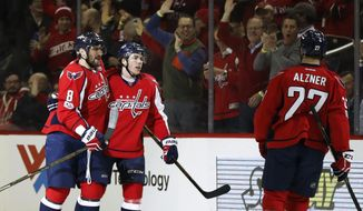 Washington Capitals right wing T.J. Oshie, center, celebrates his first period goal with teammate Alex Ovechkin (8) of Russia during the first period of an NHL hockey game in Washington, Wednesday, Feb. 1, 2017. (AP Photo/Manuel Balce Ceneta)