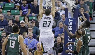 Utah Jazz center Rudy Gobert (27) scores as Milwaukee Bucks' Malcolm Brogdon (13), Jason Terry (3) and Thon Maker (7) look on in the first half during an NBA basketball game, Wednesday, Feb. 1, 2017, in Salt Lake City. (AP Photo/Rick Bowmer)