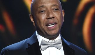 FILE - In this Feb. 6, 2015, file photo, hip-hop mogul Russell Simmons presents the Vanguard Award on stage at the 46th NAACP Image Awards in Pasadena, Calif. On Wednesday, Feb. 1, 2017, the Consumer Financial Protection Bureau said it has ordered  Simmons' company RushCard to pay $13 million in fines and restitution related to a 2015 outage that cut off its customers from their money. (Photo by Chris Pizzello/Invision/AP, File)