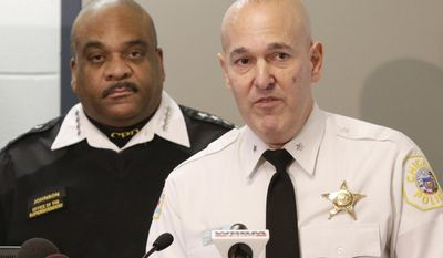 Jonathan Lewin, Deputy Chief Technology and Records Group with the Chicago Police Department accompanied by Police Superintendent Eddie Johnson speaks at a news conference Wednesday, Feb. 1, 2017, in Chicago. The Police Department unveiled new high-tech crime-fighting strategies as the city deals with increases in homicides and gang violence. Supt. Johnson also released crime figures that show there were 51 homicides during January, or a 1 percent increase over last year. (AP Photo/Teresa Crawford)