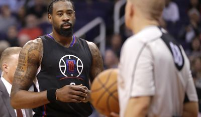 Los Angeles Clippers center DeAndre Jordan stares at a referee as he leaves the court after a flagrant foul call during the second half of the team's NBA basketball game against the Phoenix Suns, Wednesday, Feb. 1, 2017, in Phoenix. Jordan was ejected from the game. (AP Photo/Matt York)