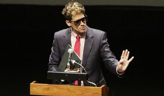 "Milo Yiannopoulos speaks at California Polytechnic State University as part of his ""The Dangerous Faggot Tour"" of college campuses, Tuesday, Jan. 31, 2017, in San Luis Obispo, Calif.  His speech was met with dozens of angry protesters outside a campus theater. (David Middlecamp/The Tribune (of San Luis Obispo) via AP) ** FILE **"