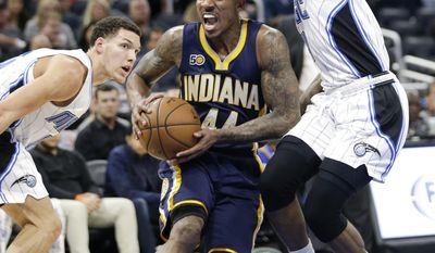 Indiana Pacers' Jeff Teague (44) moves to the basket between Orlando Magic's Aaron Gordon, left, and Elfrid Payton during the first half of an NBA basketball game, Wednesday, Feb. 1, 2017, in Orlando, Fla. (AP Photo/John Raoux)