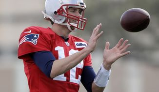 New England Patriots quarterback Tom Brady participates in a drill during practice for the NFL Super Bowl 51 football game against the Atlanta Falcons. Wednesday, Feb. 1, 2017, in Houston. (AP Photo/Charlie Riedel)