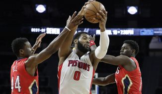 Detroit Pistons center Andre Drummond (0) runs into the defense of New Orleans Pelicans forward Solomon Hill (44) and guard Jrue Holiday during the first half of an NBA basketball game, Wednesday, Feb. 1, 2017, in Auburn Hills, Mich. (AP Photo/Carlos Osorio)