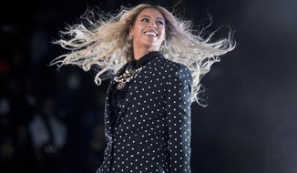 This Nov. 4, 2016, file photo shows Beyonce performing at a Get Out the Vote concert for Democratic presidential candidate Hillary Clinton in Cleveland. Beyonce announced on her Instagram account, Wednesday, Feb. 1, 2017, that she is expecting twins.  (AP Photo/Andrew Harnik, File)