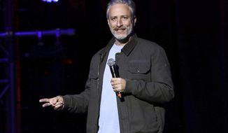 "FILE - In this Tuesday, Nov. 10, 2015, file photo, comedian Jon Stewart performs at the 9th Annual Stand Up For Heroes event, in New York. Stewart appeared dressed as President Donald Trump on CBS' ""Late Show with Stephen Colbert"" on Tuesday, Jan. 31, 2017. (Photo by Greg Allen/Invision/AP, File)"