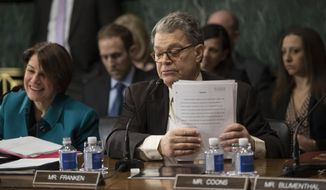 Senate Judiciary Committee Sen. Al Franken, D-Minn., accompanied by Sen. Amy Klobuchar, D-Minn., concludes his remarks on Capitol Hill in Washington, Wednesday, Feb. 1, 2017, before the committee voted to approve the nomination of Attorney General-designate Sen. Jeff Sessions, R-Ala., following angry exchanges between Republicans and Democrats. (AP Photo/J. Scott Applewhite)
