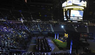 "A crowd sits in Crisler Center during University of Michigan's ""Signing of the Stars"" event on national signing day at Crisler Center in Ann Arbor, Mich., Wednesday, Feb. 1, 2017. (Melanie Maxwell/The Ann Arbor News via AP)"