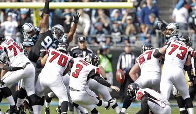 FILE - In this Dec. 24, 2016, file photo, Atlanta Falcons' Matt Bryant (3) kicks a field goal against the Carolina Panthers in the first half of an NFL football game in Charlotte, N.C. Bryant is 41, not too old to finally make it to his first Super Bowl. The Falcons' kicker is a testament to perseverance, and truly appreciative to finally get his chance in the big game. (AP Photo/Bob Leverone, File)