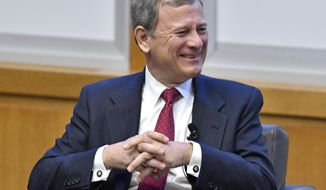 Chief Justice John Roberts reacts to a question from during panel discussion at the The John G. Heyburn II Initiative and University of Kentucky College of Law's judicial conference and speaker series, Wednesday, Feb. 1, 2017, in Lexington, Ky. (AP Photo/Timothy D. Easley)