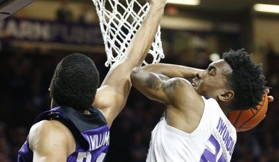 Kansas State forward Wesley Iwundu (25) grabs a rebound from TCU guard Kenrich Williams (34) during an NCAA college basketball game Wednesday, Feb. 1, 2017, in Manhattan, Kan. (Bo Rader/The Wichita Eagle via AP)