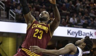 Cleveland Cavaliers' LeBron James (23) drives to the basket against Minnesota Timberwolves forward Andrew Wiggins (22) in the first half of an NBA basketball game, Wednesday, Feb. 1, 2017, in Cleveland. (AP Photo/Tony Dejak)