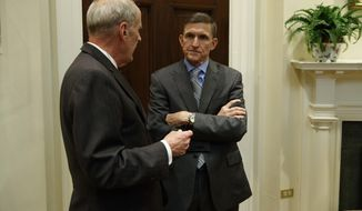 National Security Adviser Mike Flynn, right, talks with Ret. Gen. Keith Alexander before a meeting with President Donald Trump on cyber security in the Roosevelt Room of the White House in Washington, Tuesday, Jan. 31, 2017. (AP Photo/Evan Vucci)