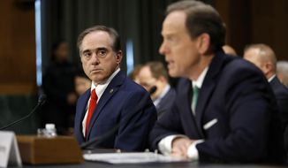 Veterans Affairs Secretary-designate Dr. David Shulkin, currently undersecretary for health at the VA, listens at left as Sen. Pat Toomey, D-Pa. introduces him on Capitol Hill in Washington, Wednesday, Feb. 1, 2017, at his confirmation hearing before the Senate Veterans' Affairs Committee. (AP Photo/Alex Brandon)