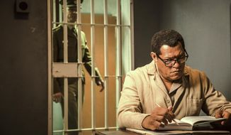 "This image released by BET shows Laurence Fishburne as Nelson Mandela in a scene from, ""Madiba,"" a six-hour miniseries premiering on Wednesday, Feb. 1. (Marcos Cruz/BET via AP)"
