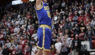 UCLA forward TJ Leaf goes up for a dunk during the second half of an NCAA college basketball game against Washington State in Pullman, Wash., Wednesday, Feb. 1, 2017. UCLA won 95-79. (AP Photo/Young Kwak)