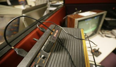 """In this May 20, 2016 photo, an Atari console is seen at the Computer and Video Game Archive at the Duderstadt Center at the University of Michigan in Ann Arbor, Mich. The university's archive features over 7,000 titles - everything from time-honored favorites such as """"Pac-Man"""" and """"Frogger"""" to newer fare, including """"Call of Duty"""" and """"Halo"""" - on dozens of gaming systems. And unlike some other video game archives out there, students and members of the public alike are permitted to visit and play any game available, whether for research or just to relax. (AP Photo/Carlos Osorio)"""