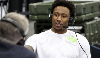 New York Jets Brandon Marshall is seen doing an interview on Radio Row on Thursday, February 2, 2017 in Houston, TX. (AP Photo/Gregory Payan)