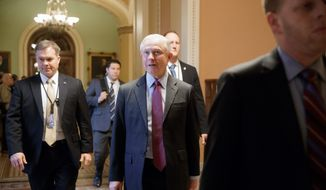 Attorney General-designate Sen. Jeff Sessions, R-Ala., is surrounded by security as he walks on Capitol Hill in Washington, Wednesday, Feb. 1, 2017,  as the Senate Judiciary Committee prepares to advance his nomination. (AP Photo/J. Scott Applewhite)