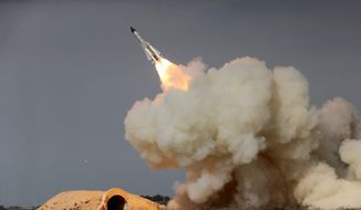 "The Treasury Department's Office of Foreign Assets Control said last week that a ""Chinese-based network"" was helping procure goods for Iran's ballistic missile program. (Associated Press/File)"
