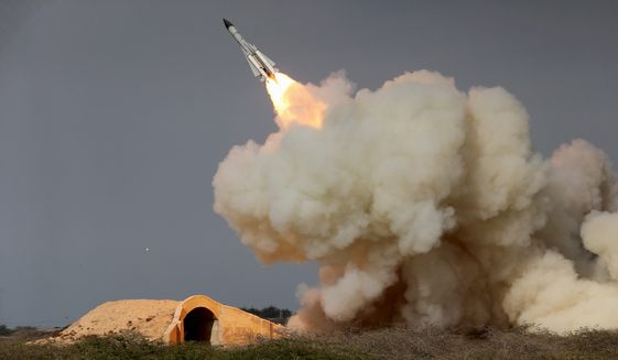 Iranian dissidents have documented work at 42 missile centers operated by the Islamic Revolutionary Guard Corps, the regime's dominant security force. A dozen of those sites had never been disclosed before. (Associated Press/File)