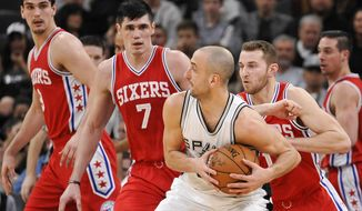 San Antonio Spurs guard Manu Ginobili, center right, of Argentina, tangles with Philadelphia 76ers' Ersan Ilyasova (7), of Turkey, and T.J. McConnell (1) during the first half of an NBA basketball game, Thursday, Feb. 2, 2017, in San Antonio. (AP Photo/Darren Abate)