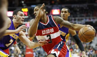 Washington Wizards guard Bradley Beal (3) drives the ball against Los Angeles Lakers forward Larry Nance Jr. (7) during the second half of an NBA basketball game in Washington, Thursday, Feb. 2, 2017. (AP Photo/Manuel Balce Ceneta)