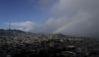 A rainbow is shown from Bernal Heights Hill in San Francisco, Monday, Jan. 23, 2017. (AP Photo/Jeff Chiu)
