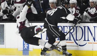 Colorado Avalanche right wing Rene Bourque, left, and Los Angeles Kings defenseman Brayden McNabb collide during the first period of an NHL hockey game, Wednesday, Feb. 1, 2017, in Los Angeles. (AP Photo/Mark J. Terrill)
