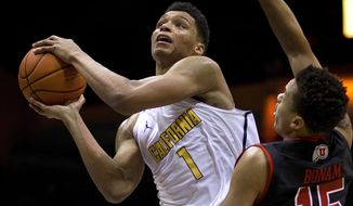 California's Ivan Rabb, left, looks to shoot past Utah's Lorenzo Bonam (15) in the first half of an NCAA college basketball game Thursday, Feb. 2, 2017, in Berkeley, Calif. (AP Photo/Ben Margot)