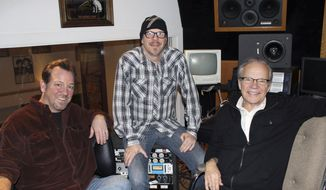 FILE - In this Dec. 18, 2013, file photo, pop singer Bobby Vee, right, poses with sons Jeff Velline, left, and Tommy Velline, at his family's Rockhouse Productions in St. Joseph, Minn. Two of Vee's four children have filed a court petition claiming their siblings are misusing money from the late singer's estate. Robby Velline and Jennifer Whittet Velline claim in the petition that their brothers, Tommy and Jeff, have used money from the estate for their personal benefit and to support Rockhouse Productions. Tommy and Jeff have filed a counter petition that says their actions had the approval of their parents. Bobby Vee died in October 2016 of advanced Alzheimer's disease. (AP Photo/Jeff Baenen, File)