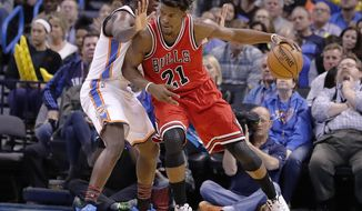 Chicago Bulls forward Jimmy Butler (21) drives to the basket as Oklahoma City Thunder guard Victor Oladipo (5) defends during the first half of an NBA basketball game in Oklahoma City, Wednesday, Feb. 1, 2017. (AP Photo/Alonzo Adams)