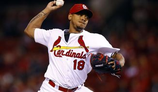 FILE - In this Sept. 30, 2016, file photo, St. Louis Cardinals starting pitcher Carlos Martinez throws during the first inning of a baseball game against the Pittsburgh Pirates in St. Louis. The  Cardinals and Martinez have agreed to a $51 million, five-year contract extension that buys out his arbitration years and includes two team options, according a person direct knowledge of the deal. The person spoke Thursday, Feb. 2, 2017,  on condition of anonymity because terms have not been released. (AP Photo/Billy Hurst, File)
