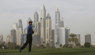 Tiger Woods follows his ball on the 13th hole during the 1st round of the Dubai Desert Classic golf tournament in Dubai, United Arab Emirates, Thursday, Feb. 2, 2017. (AP Photo/Kamran Jebreili)