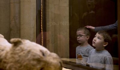 """ADVANCE FOR SATURDAY FEB 4 AND THEREAFTER - In a Monday, Jan. 23, 2017 photo, Ben Strauss, 5, of Ross Township, left, and John Balkovec, 4, of Ambridge, right, look at the """"Arab Courier Attacked by Lions"""" diorama on display at the Carnegie Museum of Natural History in Pittsburgh, Pa. (Nate Smallwood/Pittsburgh Tribune-Review via AP)"""