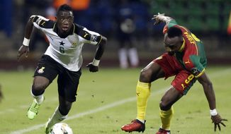 Ghana's Afriyie Acquah, left, is challenged by Cameroon's Zoua Daogari Jacques during the African Cup of Nations semifinal soccer match between Cameroon and Ghana at the Stade de Renovation, in Franceville, Gabon, Thursday, Feb. 2, 2017. (AP Photo/Sunday Alamba)